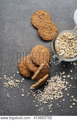Homemade Oatmeal Cookies On Grey Table Background. Healthy Food Snack Concept