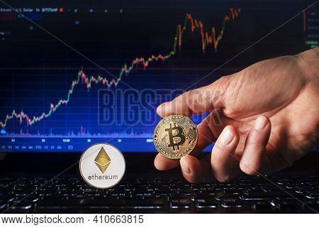 Business Men Holding Bitcoin And Ethereum Coin Whit Computer Trading Chart Background. Bitcoin And A