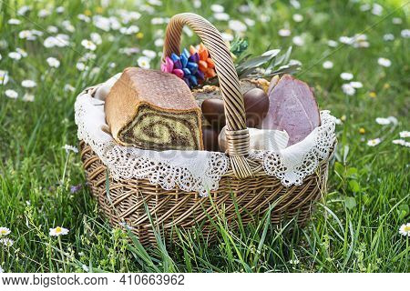 Easter Traditional Food With Ham, Eggs And Bread In Basket. Holidays Background Outdoor. Easter Bask