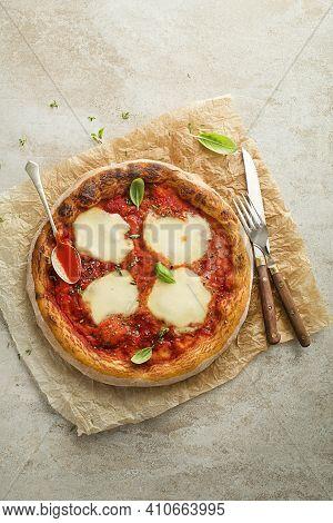 Pizza Margherita Served With Mozzarella Cheese, Tomato Sauce And Fresh Basil