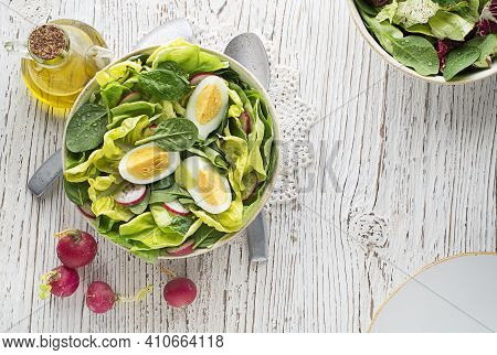 Healthy Green Salad With Egg On Wooden Table Background. Healthy Meal.