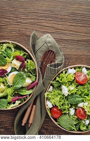Healthy Green Salads With Fresh Tomato Egg And Cheese On Wooden Background Close Up