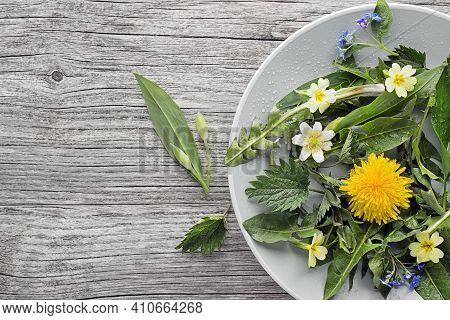 Healthy Spring Food Ingredients. Dandelion, Wild Garlic And Nettle In Plate