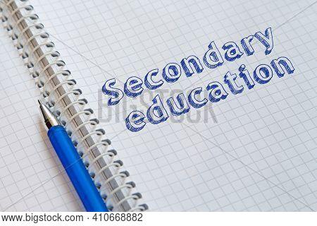 Text Secondary Education Handwritten On Sheet Of Notebook