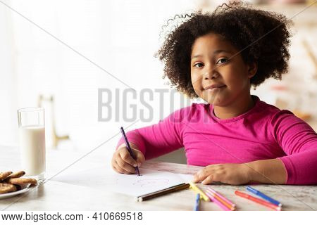 Portraif Of Smiling Black Preschooler Girl Drawing At Table In Kitchen, Cute Little African American