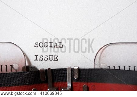 Social issue phrase written with a typewriter.