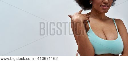 Cropped Shot Of Voluptuous Young Woman Wearing Blue Underwear Posing For Camera, Standing Isolated O