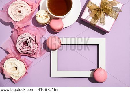 Frame Lying On A Pink Background With Cookies And Tea In Honor Of March 8. Beautiful Roses Lying On