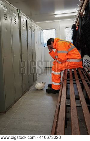 A Male Employee In The Construction Or Railway Industry Suffering Mental Health Or Grief Issues At W