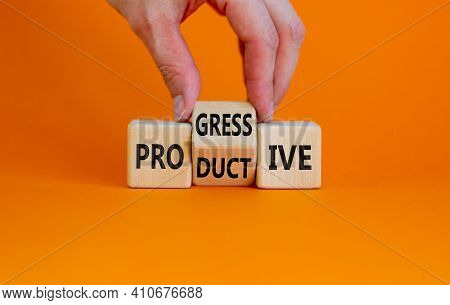 Productive And Progressive Symbol. Businessman Turns Cubes And Changes The Word 'progressive' To 'pr