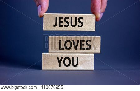 Jesus Loves You Symbol. Concept Words 'jesus Loves You' On Wooden Blocks On A Beautiful Grey Backgro