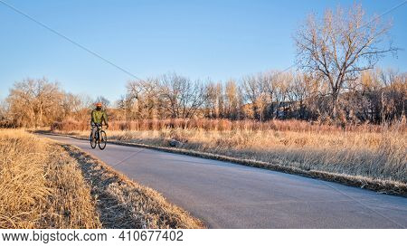 Winter or fall commuting on a bike trail - Poudre River Trail in northern Colorado
