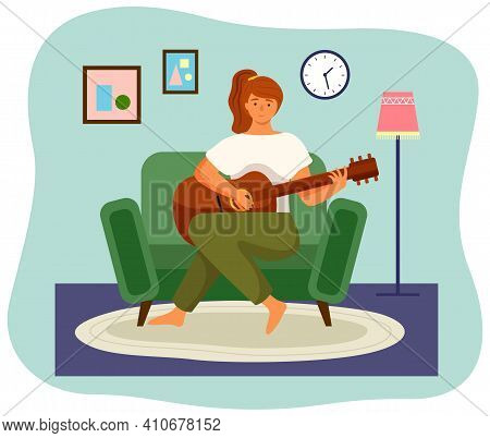 Woman Is Playing The Guitar Sitting In Armchair. Musician Composes Songs And Sings At Home. Female C