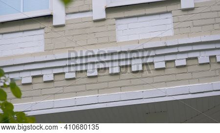 Details Of Exterior Of Brick Cottage. Stock Footage. Decorative Patterns Of Painted Bricks In Exteri