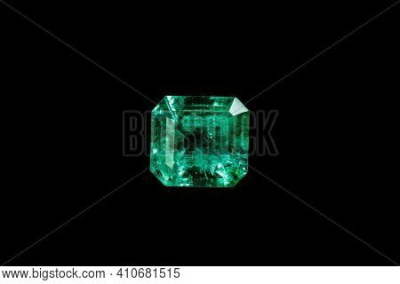 Macro Mineral Emerald Gemstone Faceted On Black Background