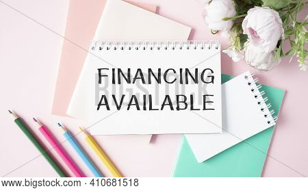 The Text Funding Is Available On The Sheet Next To A Flower, Notepad, Colored Pencils On A Pink Back