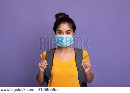 Return Back To School And Lockdown. Portrait Of Smilling Indian Female Student Wearing Surgical Medi