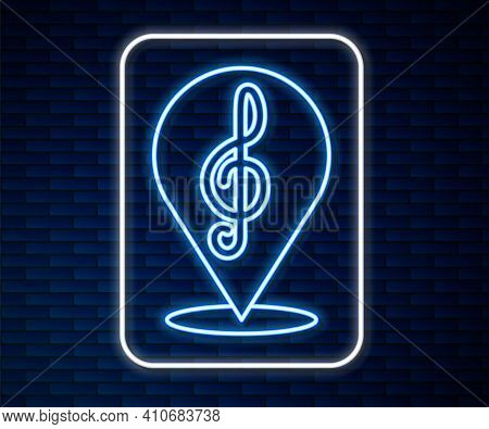 Glowing Neon Line Treble Clef Icon Isolated On Brick Wall Background. Vector