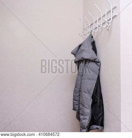 Wintercoat Hanging On A Hook In A Corridor, Hallway At The Entrance