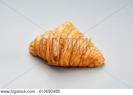 Fresh Baked Croissant. Warm Fresh Buttery Croissant On A Grey Backgroundon. French Croissant Enjoyed