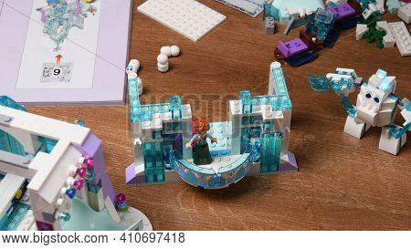 White Blue Tiny Plastic Toy Lego Dolls And Construction Blocks Of Frozen Disney Cartoon. Toy Princes