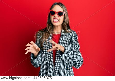 Young brunette woman wearing fashion and modern look disgusted expression, displeased and fearful doing disgust face because aversion reaction. with hands raised