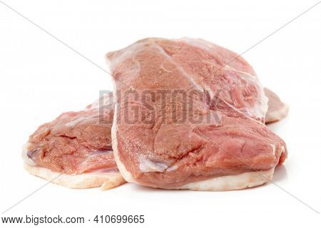 Two duck breast fillets isolated on white background, close-up