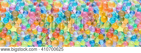 Abstract Multicolored Bright Wide Panoramic Background With Hydrogel Beads Texture. Water Absorbent