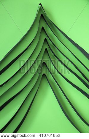 Green Abstract Tree In A Minimalist Style. Ecological Concept. Green Geometric Abstract Background.g