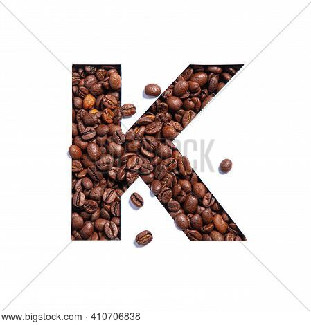 Letter K Of English Alphabet Made Of Natural Coffee Beans And Paper Cut Isolated On White. Typeface
