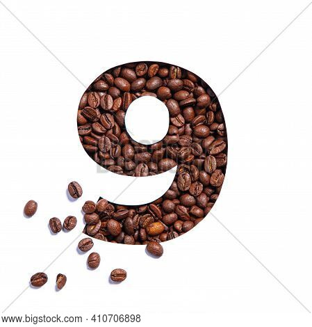 Number Nine Made Of Coffee Beans And Paper Cut In Shape Of Ninth Numeral Isolated On White. Typeface