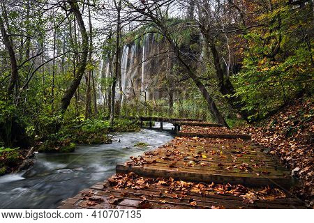 Autumn Rainy Landscape Of Waterfall And Trees In National Park Plitvice Lakes, Croatia