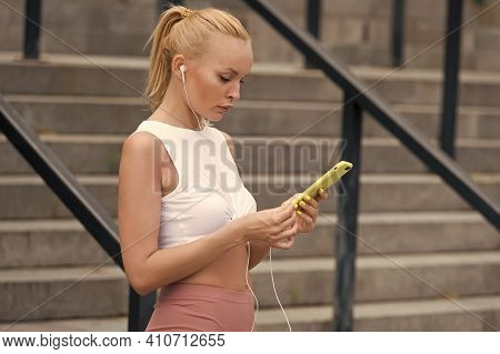 Using Smart Phone Sport Tracker Application. Sexy Woman Touch Screen Smartphone. Smart Device For He