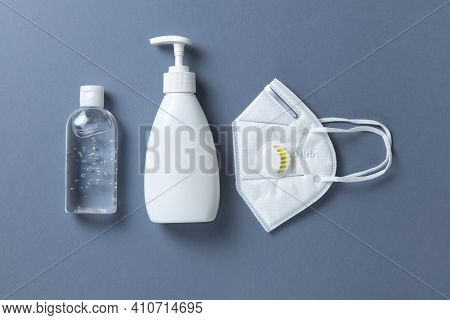 Protective, White Face Mask N 95, Building Respirator, Sanitizer Gel, Soap On Gray Background, Close