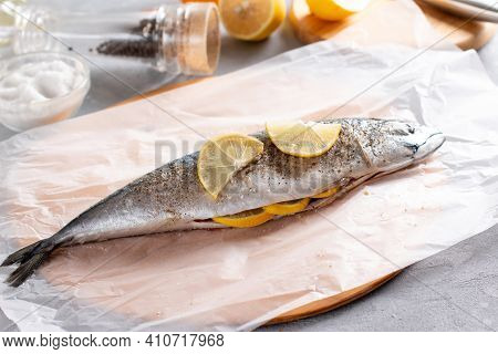 Raw Mackerel With Spices And Lemon Slices On The Table. Cooking Mackerel