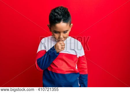Little boy hispanic kid wearing casual winter sweater feeling unwell and coughing as symptom for cold or bronchitis. health care concept.