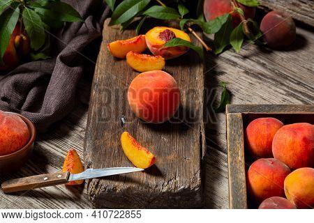 Still Life Peach On Cutting Board With Knife In Dark Key. Juicy Ripe Peaches On Dark Wooden Rustic T