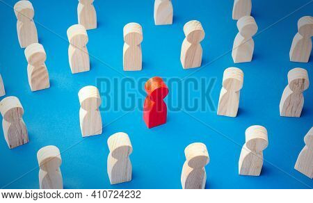 Red Man Figurine In A People Crowd. Stands Out From The Crowd. Different, Special. Collective Immuni