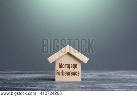 Wooden House Figurine With Inscription Mortgage Forbearance. Borrower And Lender Agreements Reduce O