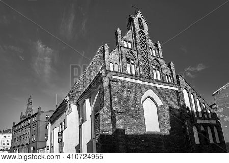 A Medieval Catholic Church And Historic Tenement Houses In Poznan, Monochrome
