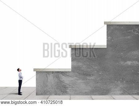 Businessman Is Small Compared To Big Stairs. Concept Of Difficult Career