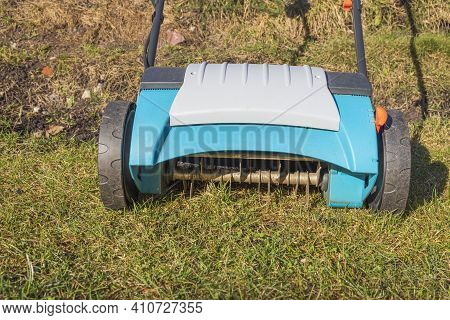 Close Up View Of Electric Lawn Aerator On Green Grass Isolated. Garden Machines Concept. Sweden.