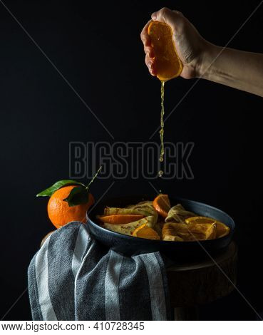 Crepes Suzette - Pancakes With Orange Sauce, Hand Squeezing Out Orange Fresh, Copy Space