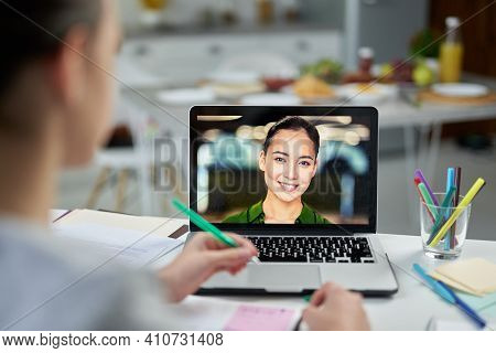 Online Study Partner. Attractive Young Female Teacher Smiling To Her Students, Using Video Chat App