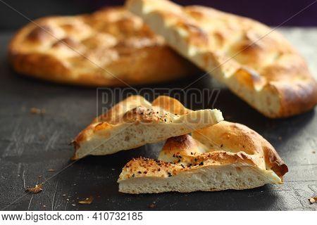 Slices Of Ramadan Pita (ramazan Pidesi) Traditional Turkish Bread For Holy Month Ramadan On Black Ba