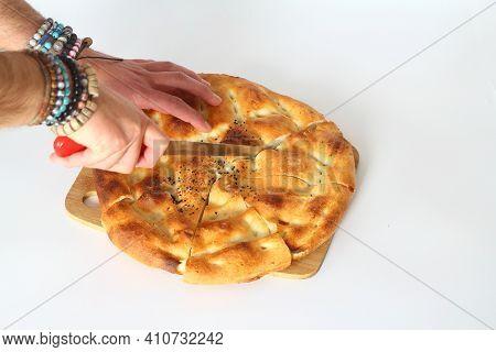 Slices Of Ramadan Pita (ramazan Pidesi) Traditional Turkish Bread For Holy Month Ramadan On White Ba
