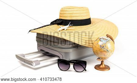 Travel Suitcase Isolated. Travel Accessories With Suitcase, Straw Hat, Toy Airplane And Globe In Min