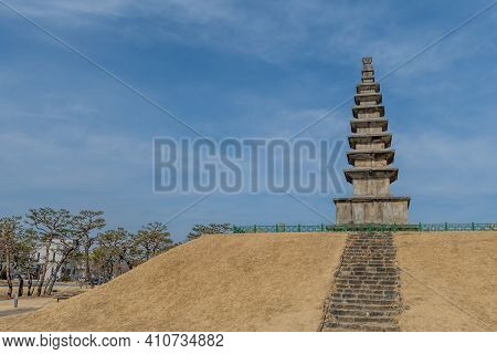 Seven Story Pagoda With Cloudy Blue Sky Background