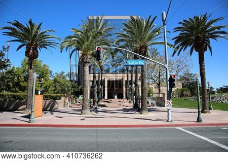 Anaheim, California - USA - March 1, 2021: Anaheim City Hall. View of Anaheim City Hall from the street with trees and rock structure. Editorial Use.
