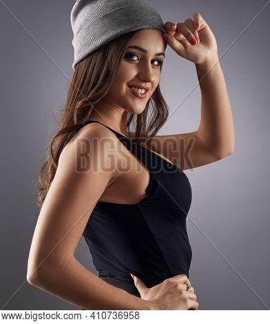 Sexy Girl In Sport Cap And Body Posing In Studio